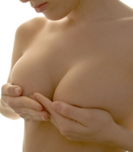 cupping breasts